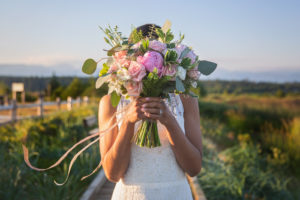 Summer Lace Bride holding Bouquet Karen Wazny Florals Vancouver Wedding Magazine