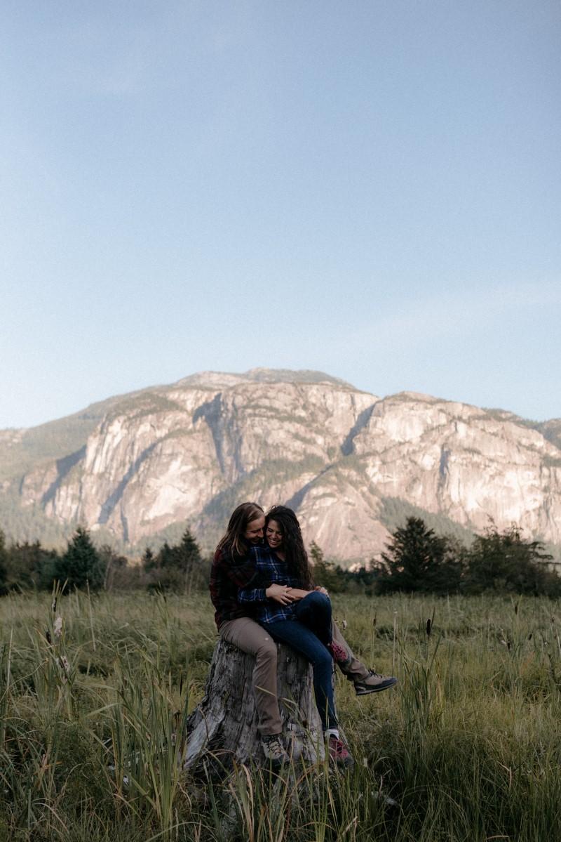 Squamish Engagement Couple with Mountains Behind West Coast Weddings Magazine