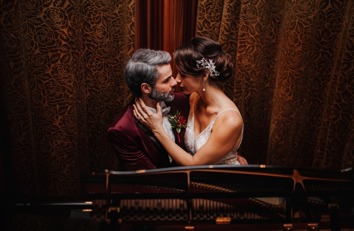 A Glamorous Holiday Wedding Newlyweds in front of fire place at Oak Bay Beach Hotel Tasha Cline Photography