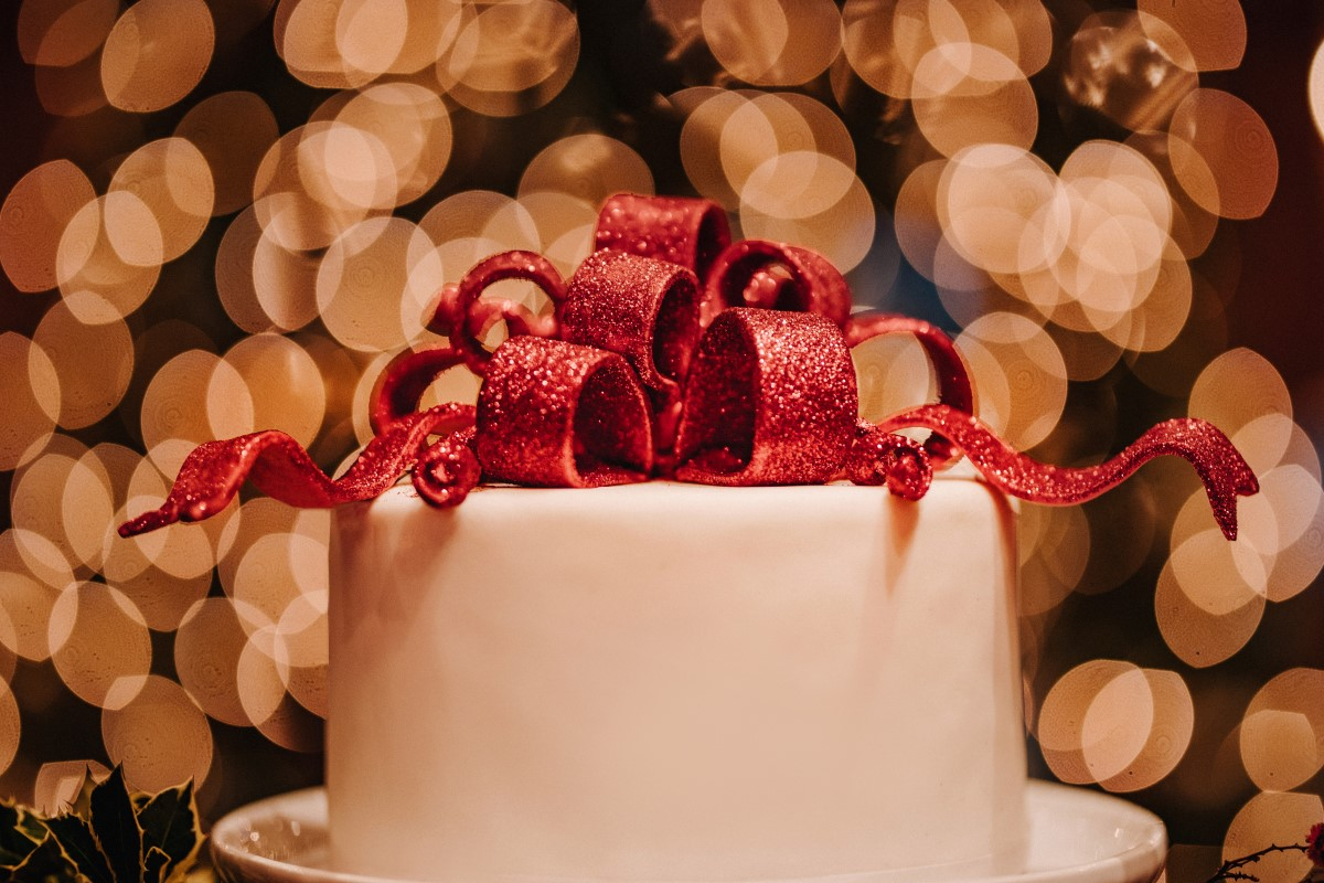 A Glamorous Holiday Wedding Cake with Red Bow Cake Topper by Cake by Taryn Vancouver Island