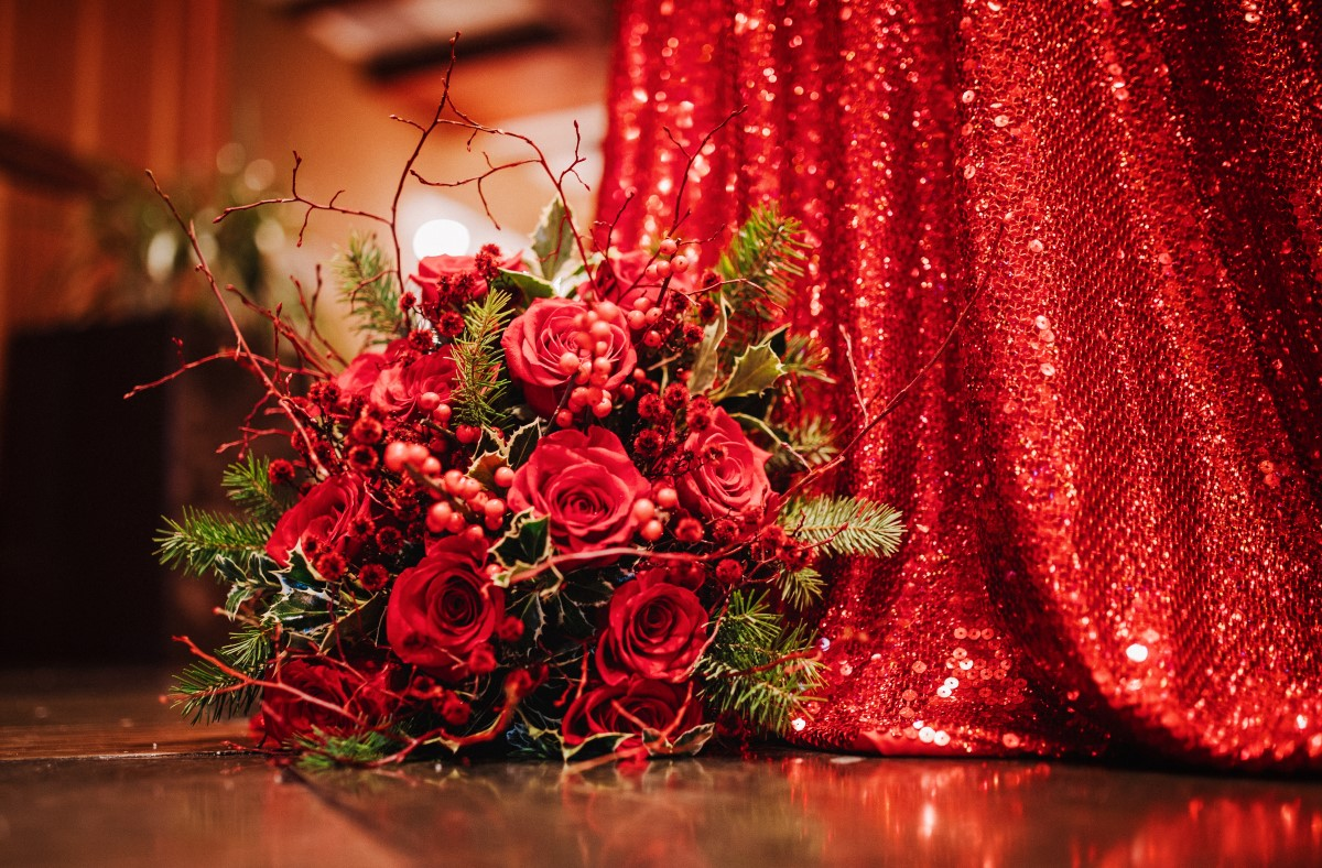 A Glamorous Holiday Wedding Bridal Bouquet Red Roses and Mistletoe