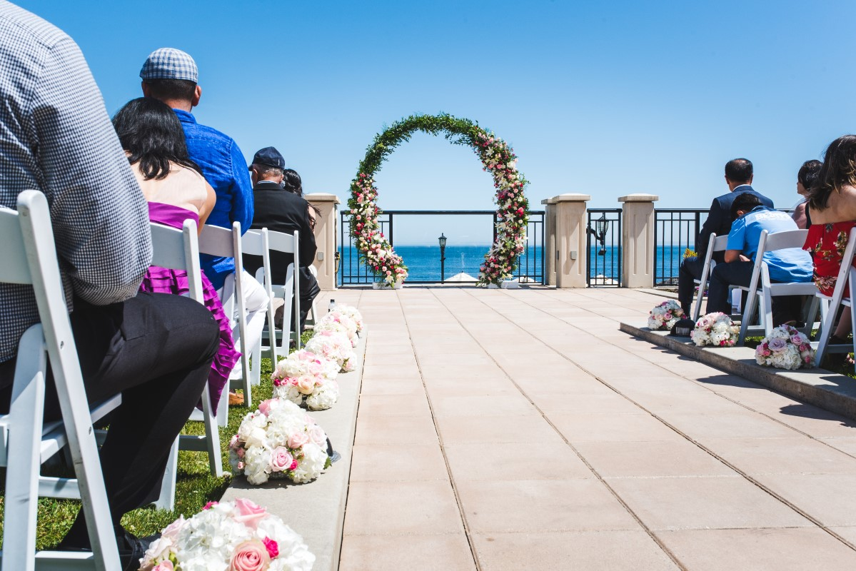 Oak Bay Beach Hotel Wedding with Decorate Victoria Round Ceremony Arch