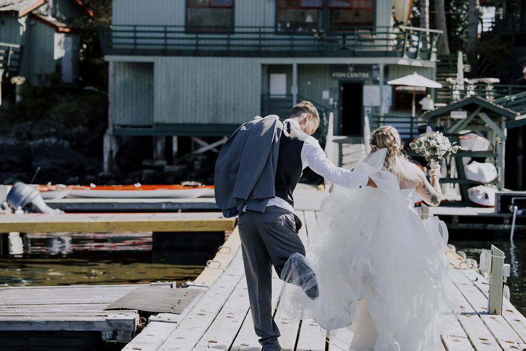 Painters Lodge Newlyweds candid photo of gown Outer Island Photography