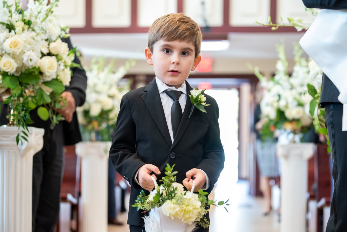 Ringbearer walks up the aisle in Vancouver wedding