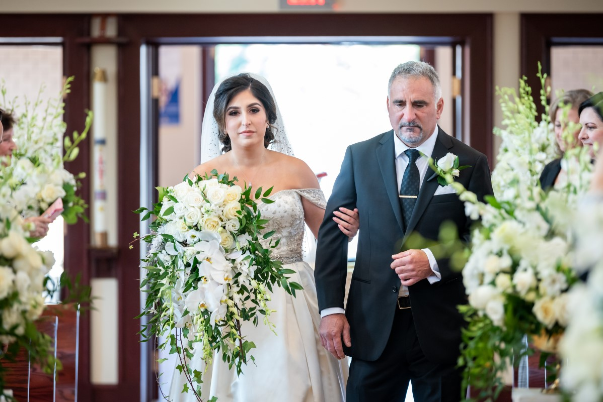 Bride and Father Walk Down the Aisle of Our Lady of Assumption Church in Vancouver