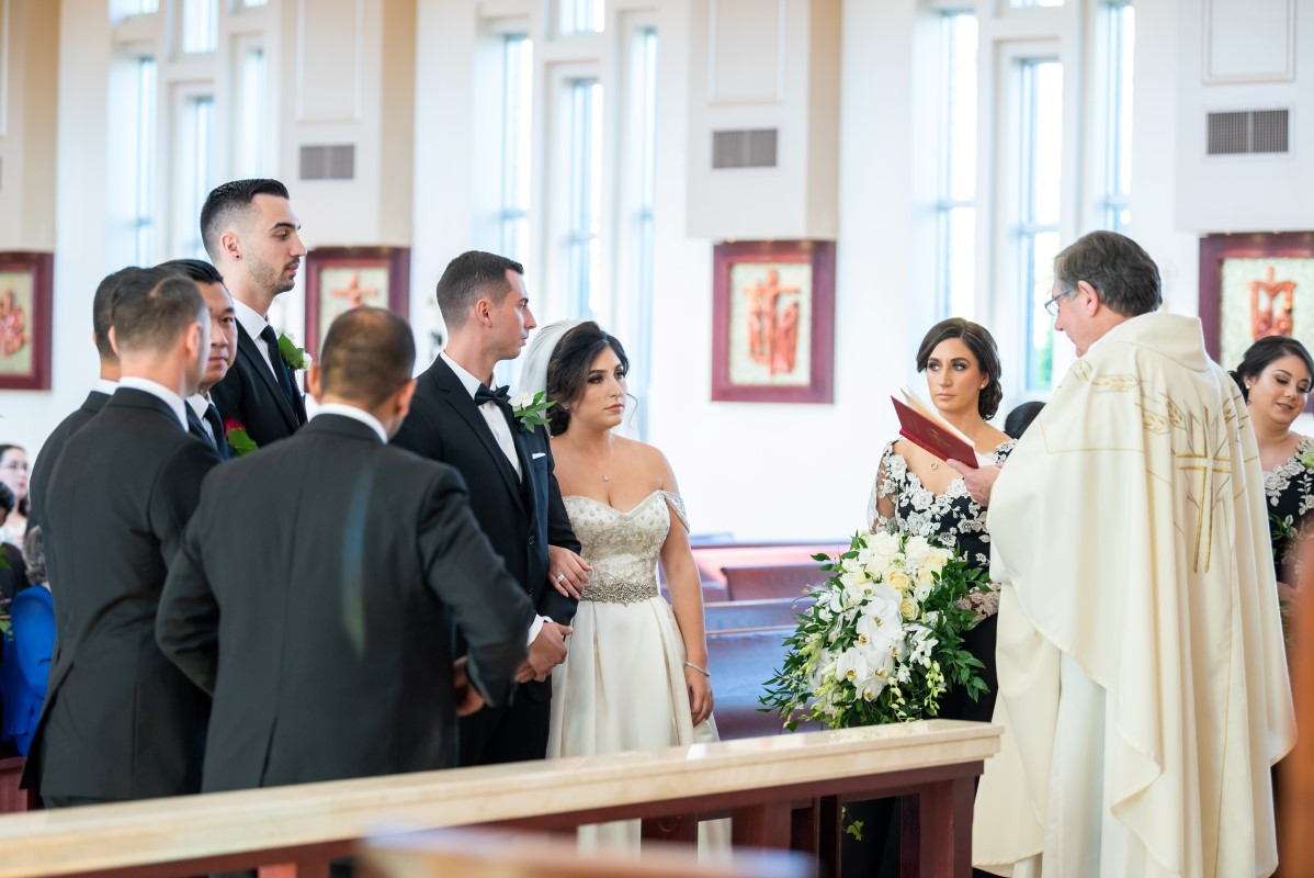 Wedding Couple at Our Lady of Assumption Church in Vancouver