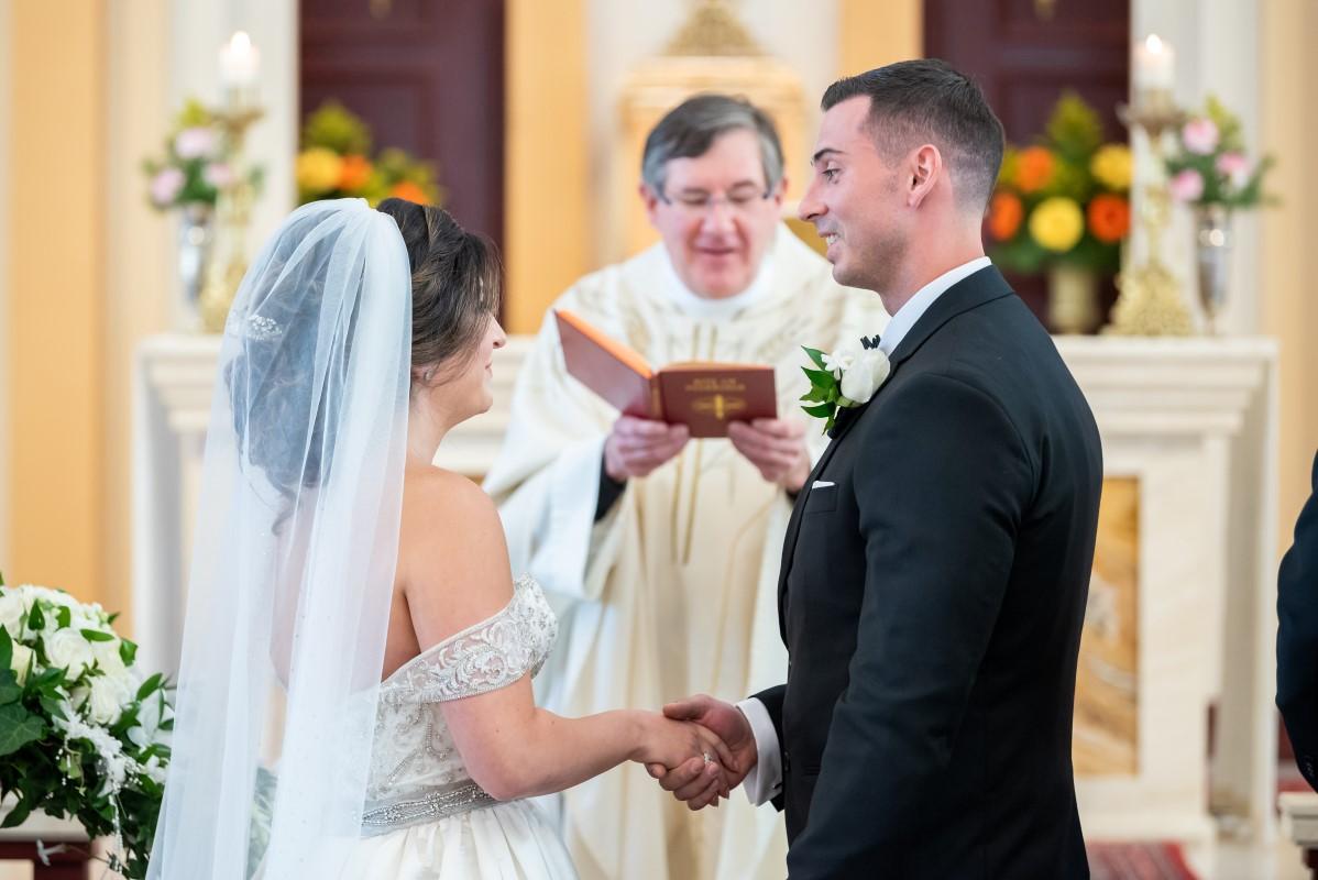 Couple exchange church wedding vows