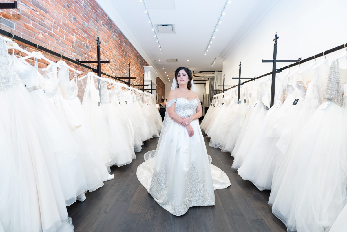 Bride shows off custom gown and veil by Victor Harper of Bridal Gallery Vancouver