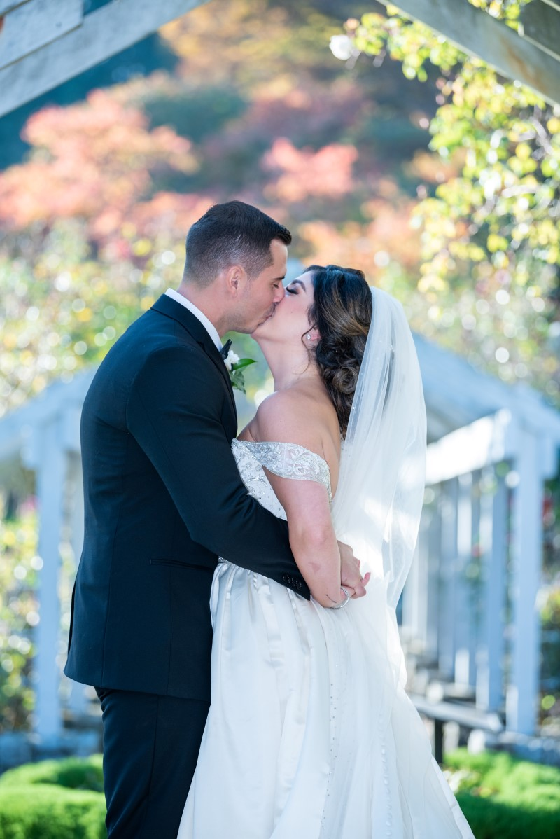 Newlyweds kiss in Vancouver Park