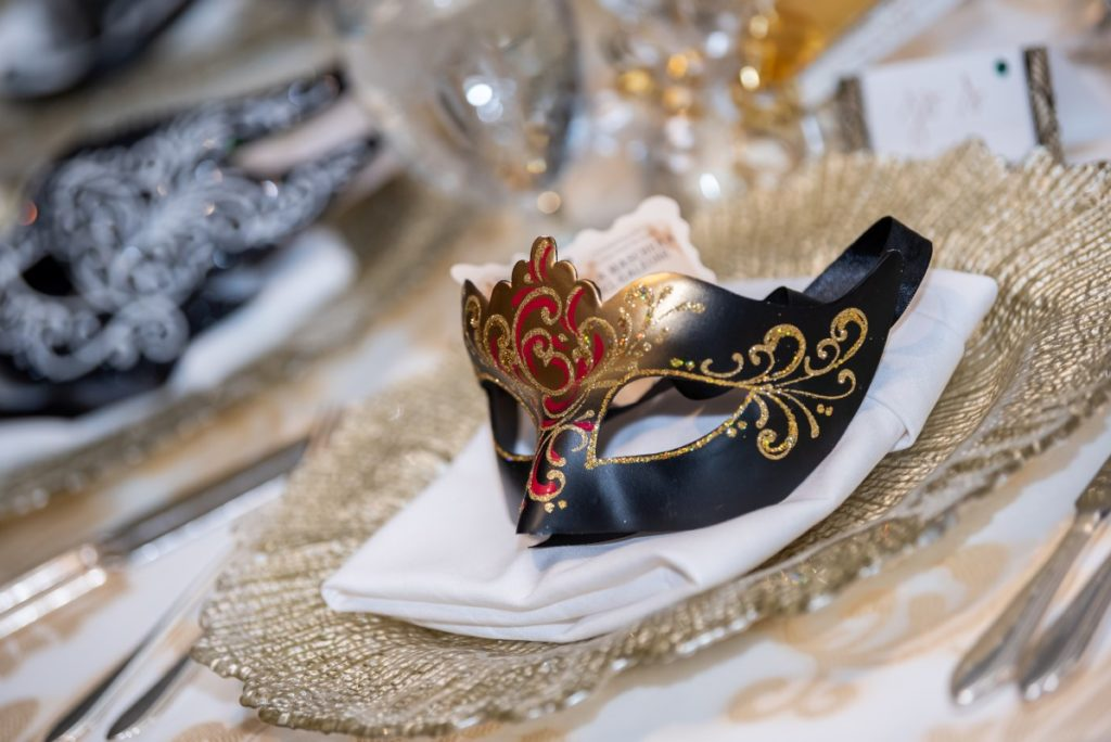 Venetian elegance mask giveaway on wedding reception tables at Vancouver Club