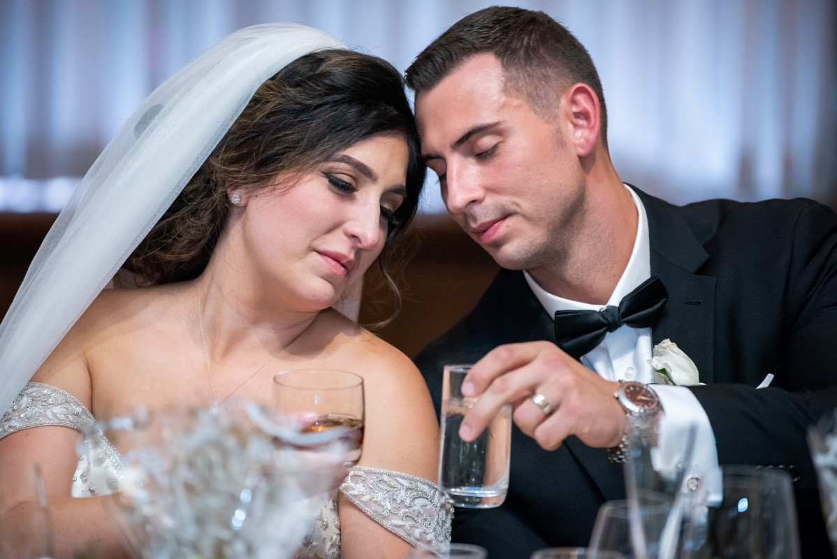 Bride and Groom tender moment at the head table during Vancouver Club reception