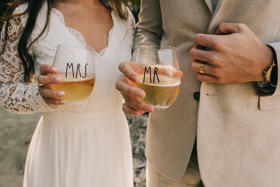 Tofino Elopement with Mr and Mrs Champagne Glasses on the beach of Vancouver Island