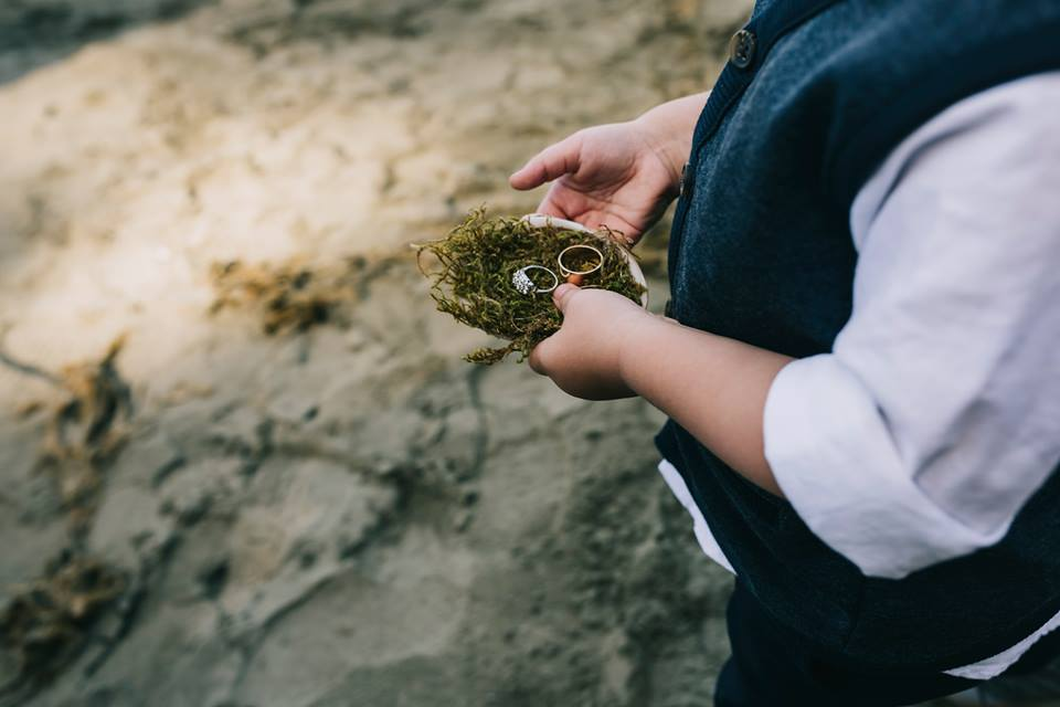 Tofino Elopement Wedding Rings brought in seashell on Tonquin Beach Vancouver Island