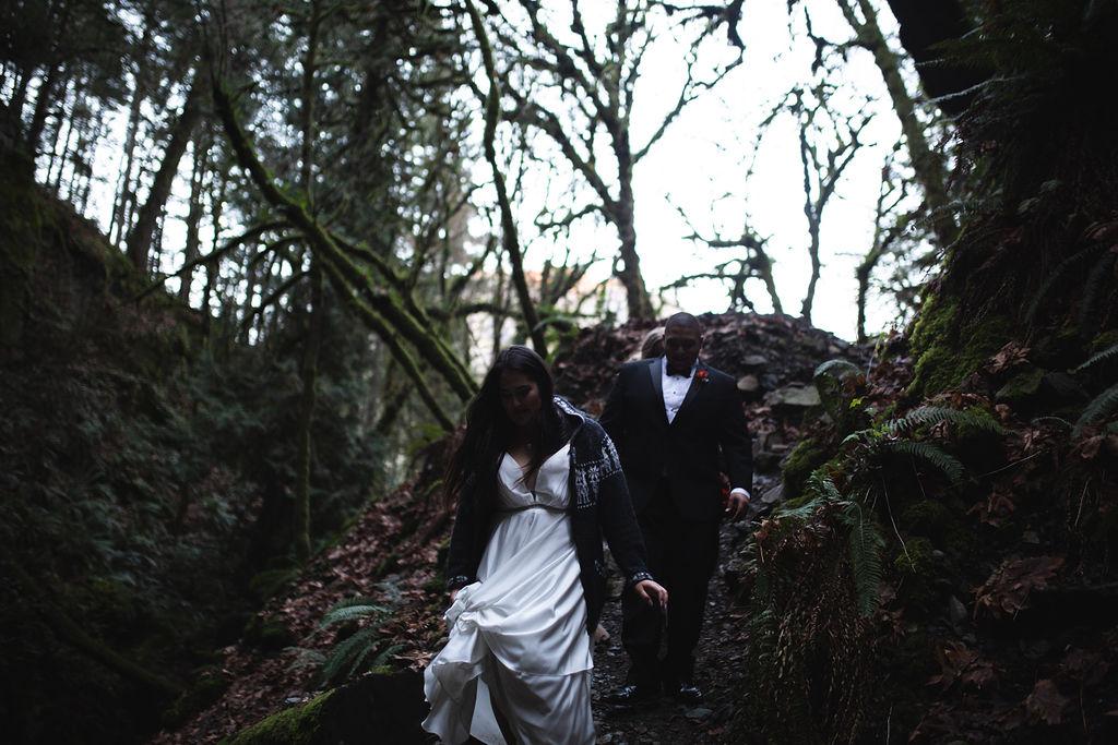 Newlyweds Walk through misty forest