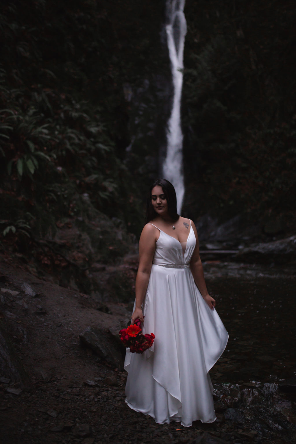 Waterfall Bride with Red floral bouquet