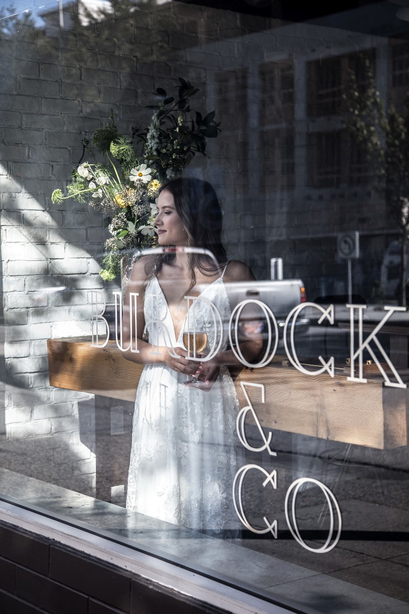 Chic wedding gown in reflection of Burdock & Co in Vancouver Wedding Magazine