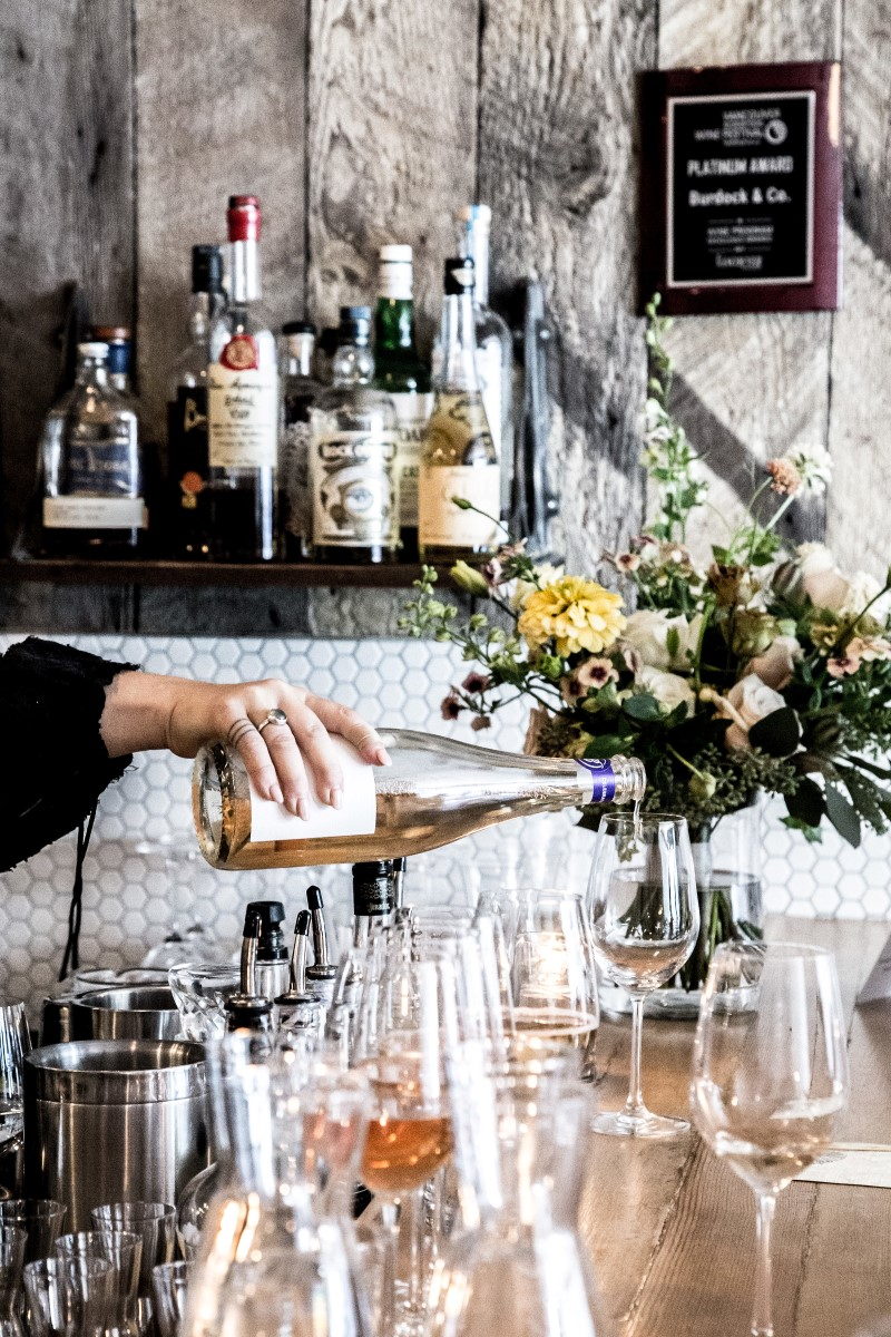 Bar pouring wine at Vancouver Wedding Magazine Venue
