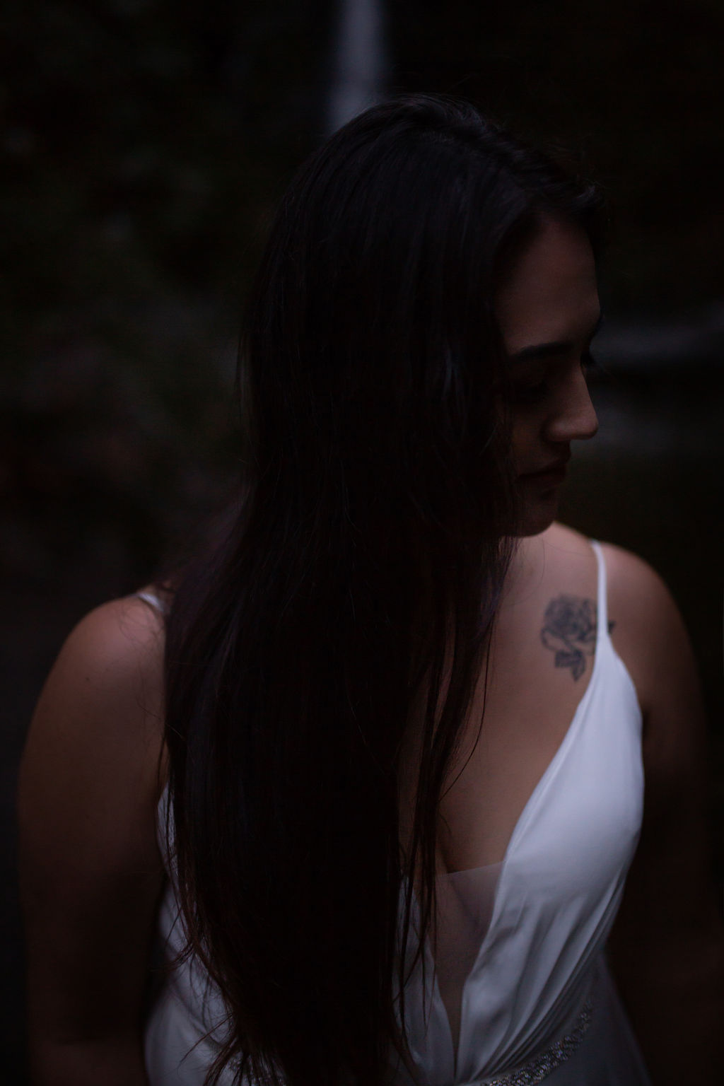 Waterfall bride with long dark hair and tattoo
