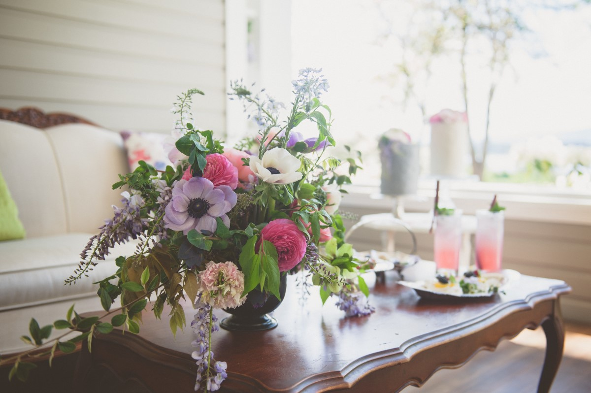 Anemones and roses on gin deck at Cowichan Valley wedding,