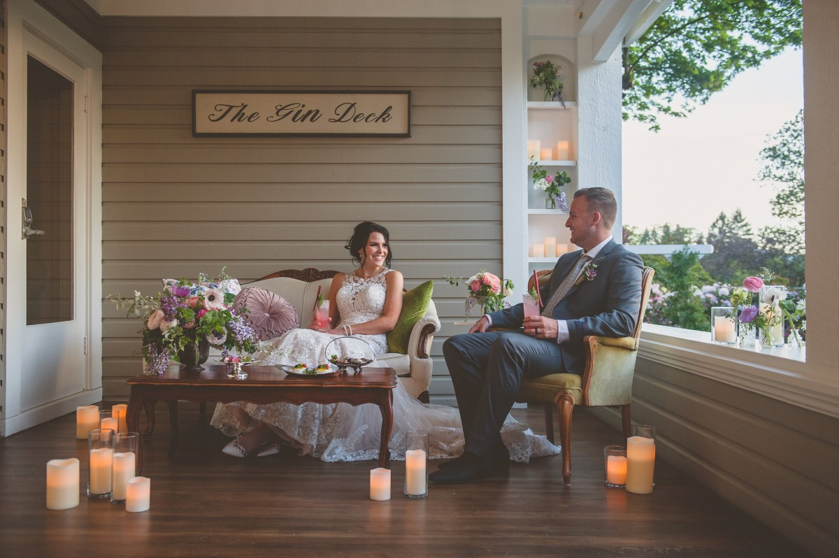 Newlyweds enjoy drink by candlelight on Gin Deck Vancouver Island
