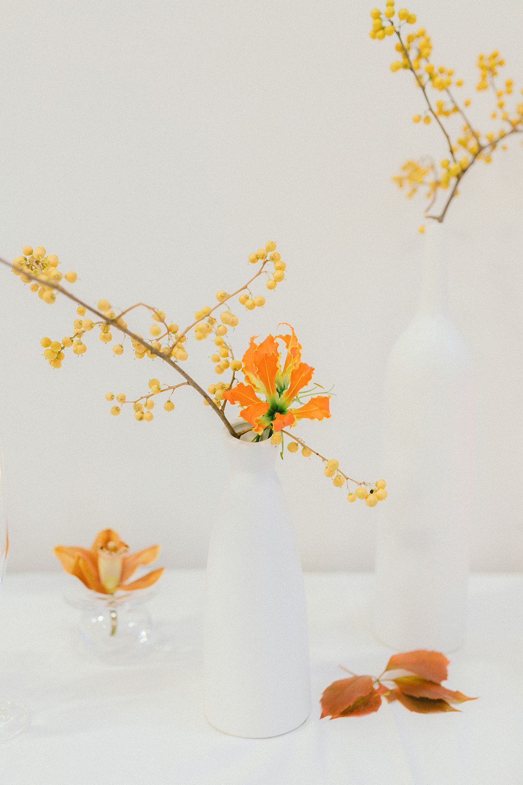 Modern Art Wedding with Orange Flowers on White Reception Table Decor in Vancouver