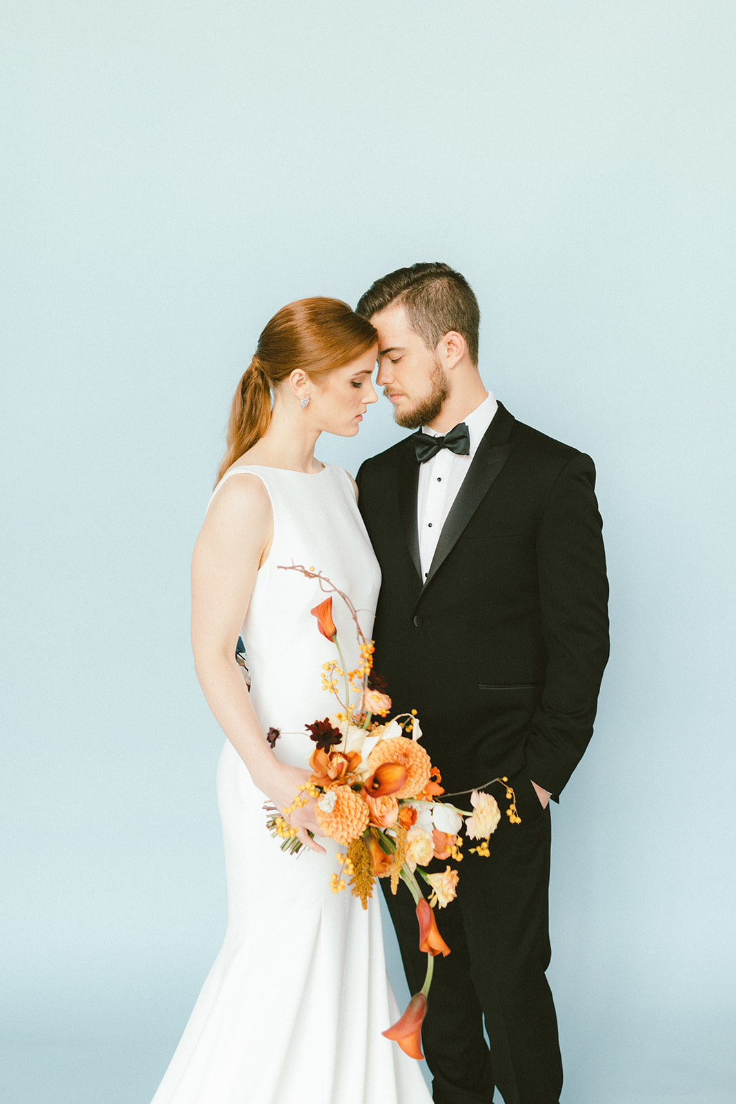 Modern Bridal Couple featuring groom in The Tux Store with bowtie Vancouver West Coast Weddings Magazine