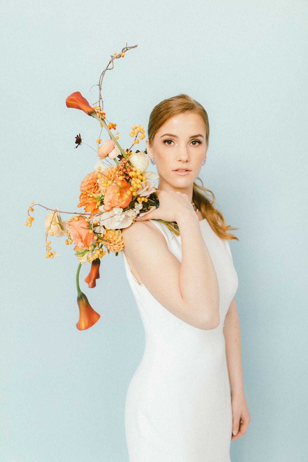 Modern Bridal Bouquet of orange dahlias and orange calla lily Da Fiori Design and Bisou Bridal
