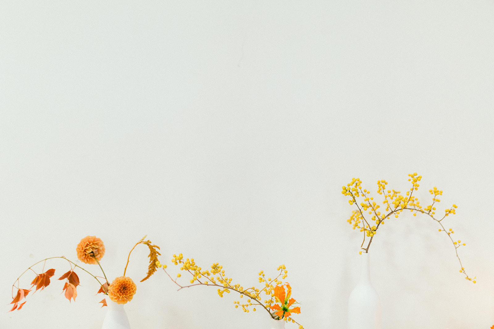 Orange and Yellow Floral on Modern Art Wedding Table by Da Fiori Vancouver Flowers
