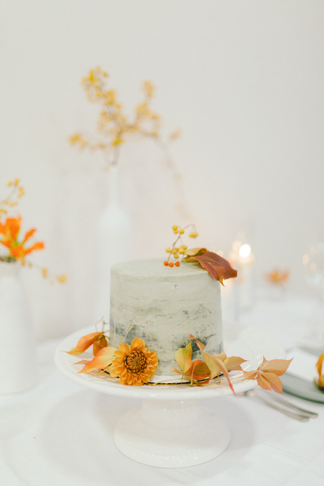 Modern Art Wedding Cake with Orange and Yellow Flowers by Jenny Bakes in Vancouver