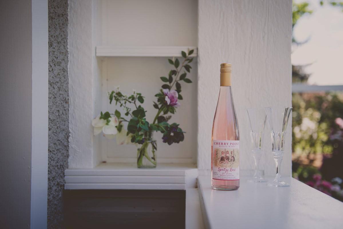 Wine sitting on deck shelf at outdoor wedding Vancouver Island Wedding Magazine
