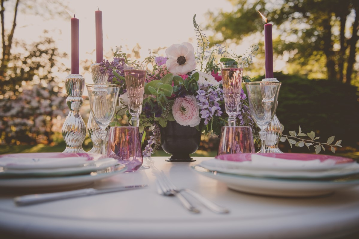 Reception sweetheart table in outdoor garden Maple Bay Manor Vancouver Island
