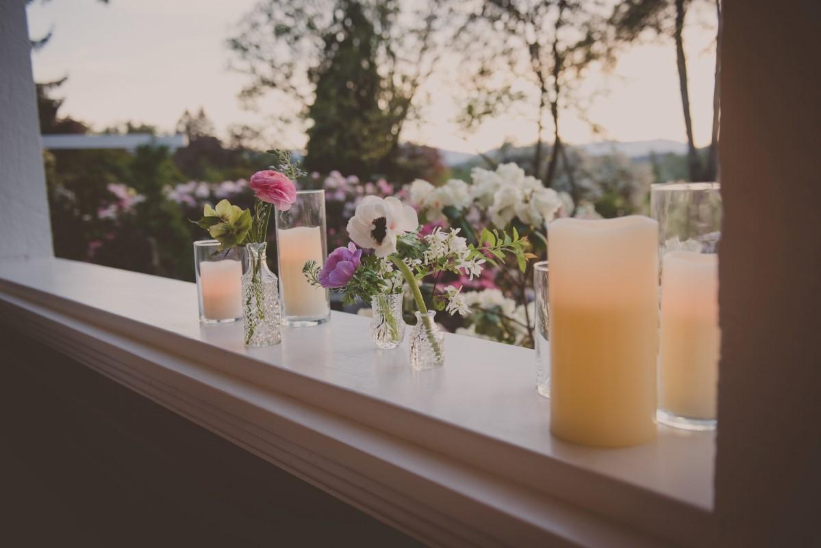 Flowers and drinks along wedding deck West Coast Weddings