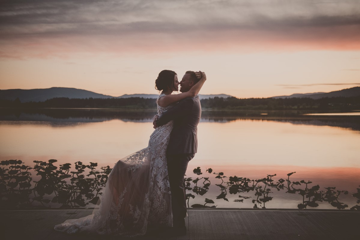 Newlyweds embrace in the sunset of Cowichan Valley West Coast Weddings