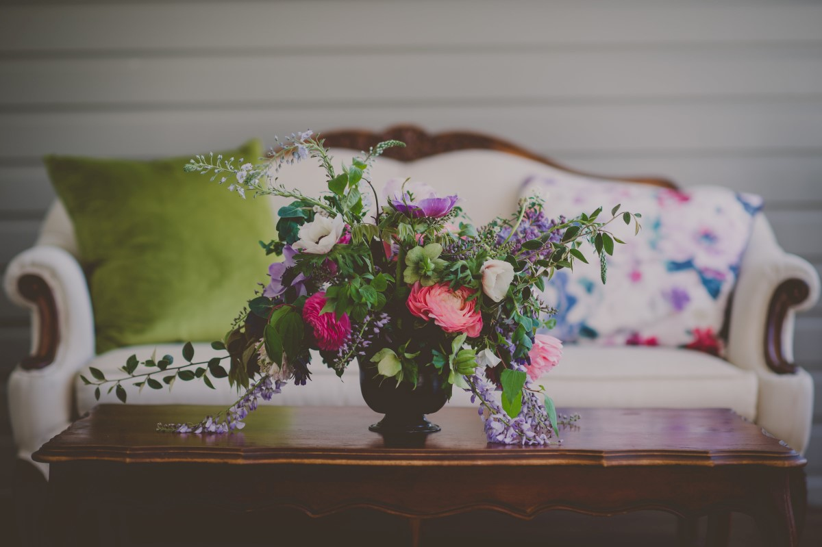 Floral Arrangement on Deck at Wedding with Vintage Couch at Maple Bay Manor