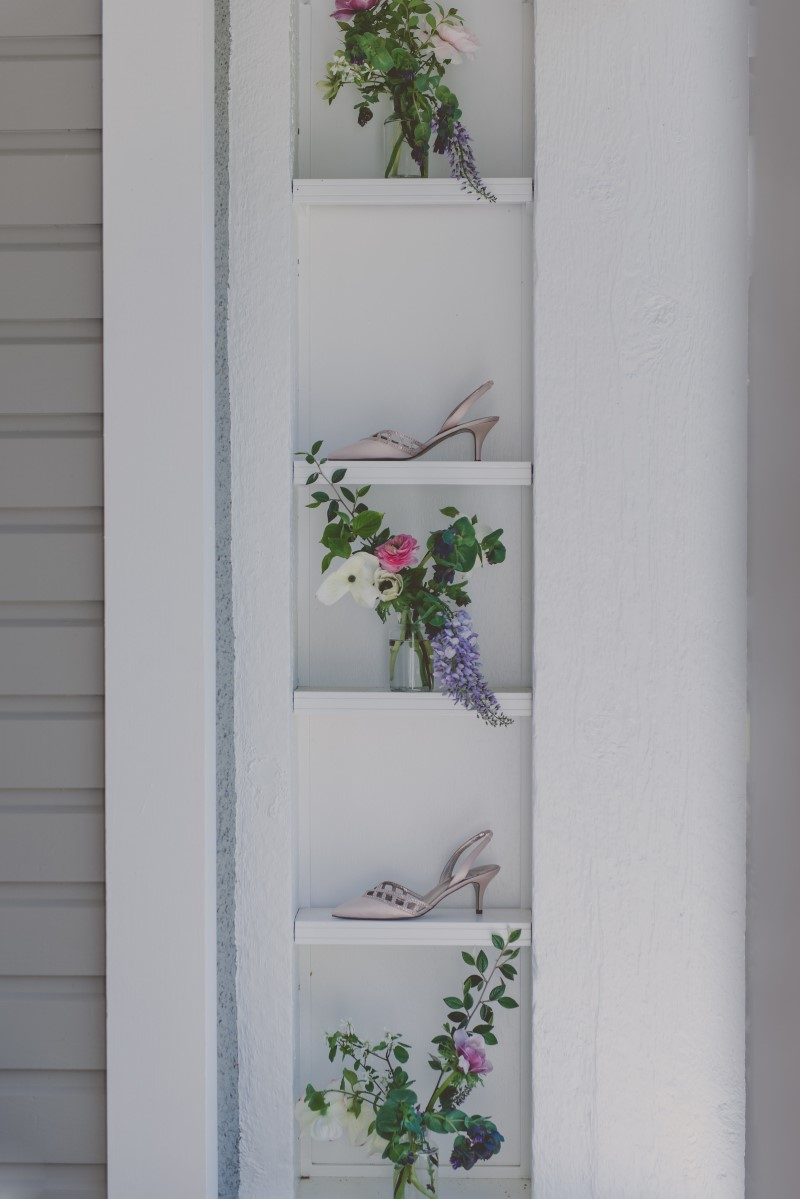Flowers and brides shoes on deck shelves at wedding venue Vancouver Island Magazine