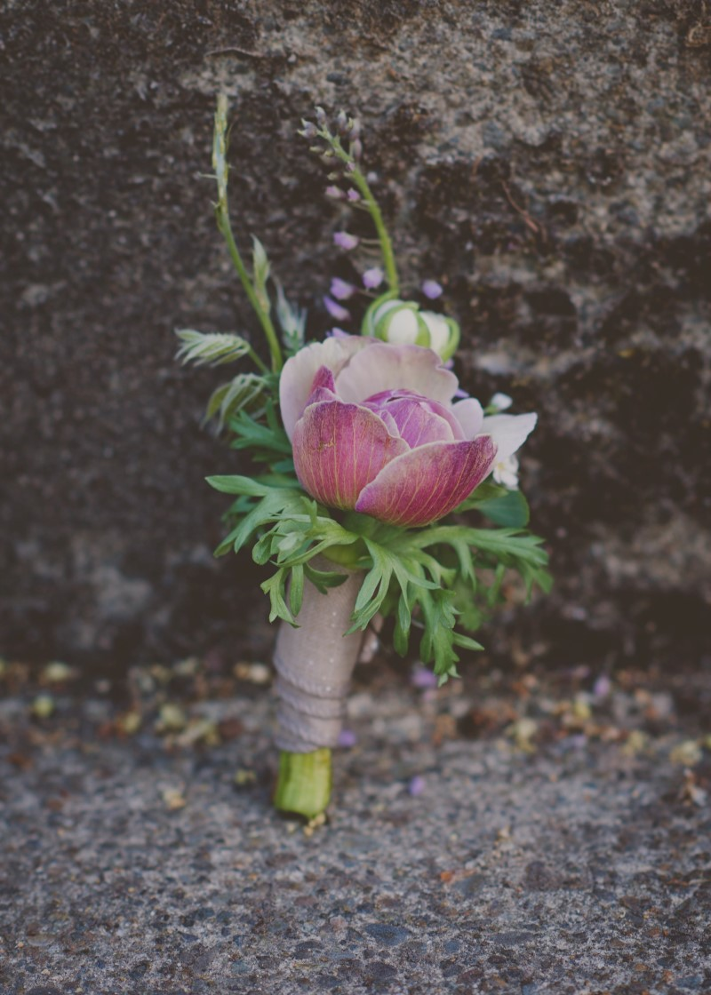 Pink grooms boutonniere with fern and wrapped in rope