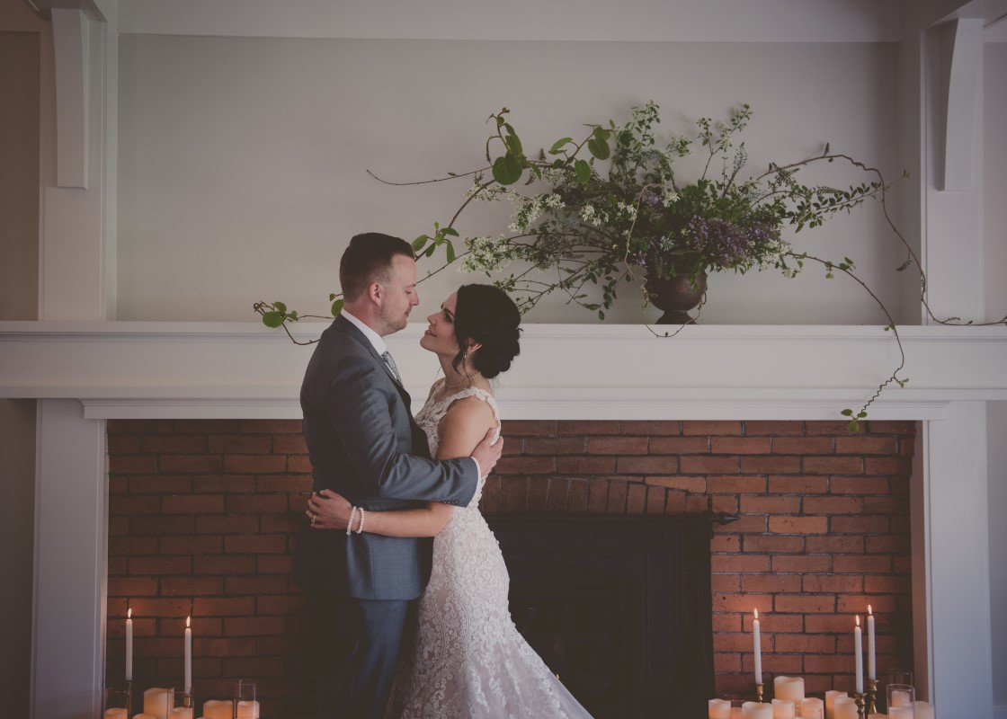 Local Love newlyweds in front of fireplace West Coast Weddings