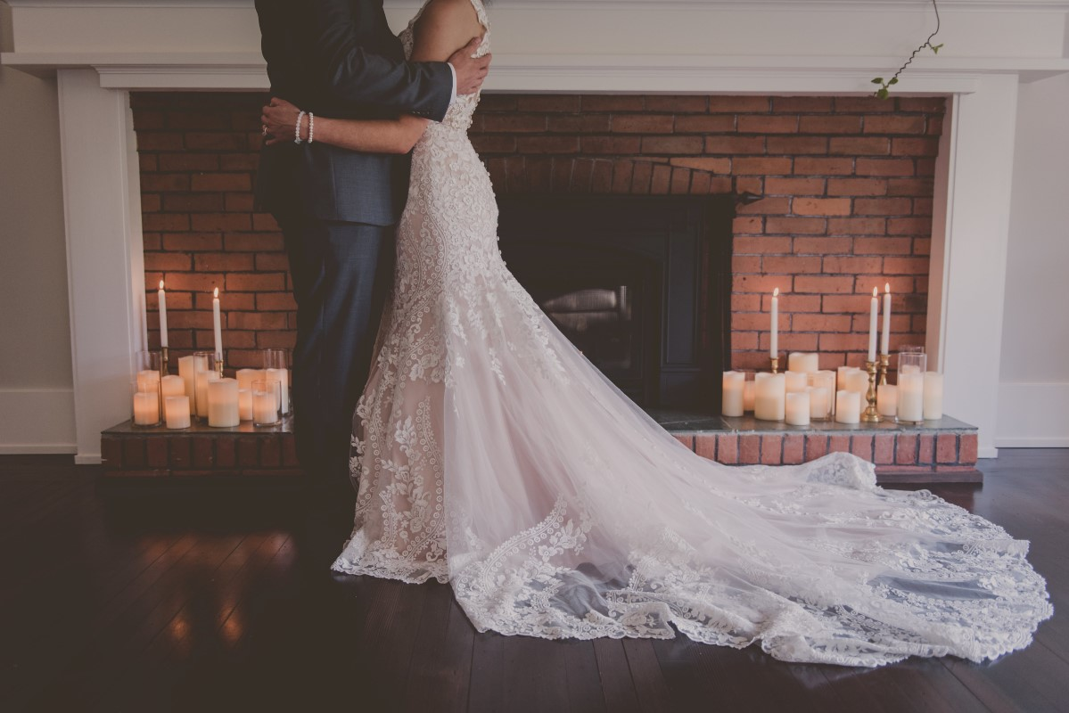 Newlyweds in front of fireplace at Maple Bay Manor Vancouver Island wedding