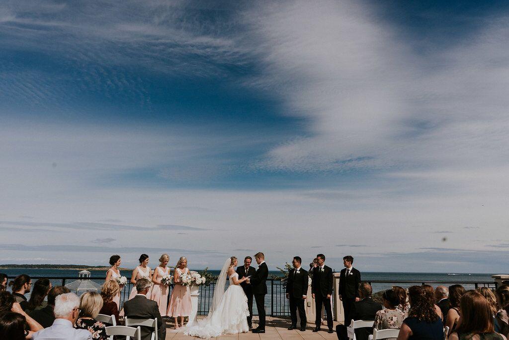 Romantic Wedding Ceremony with Blue Skies behind West Coast Weddings Magazine