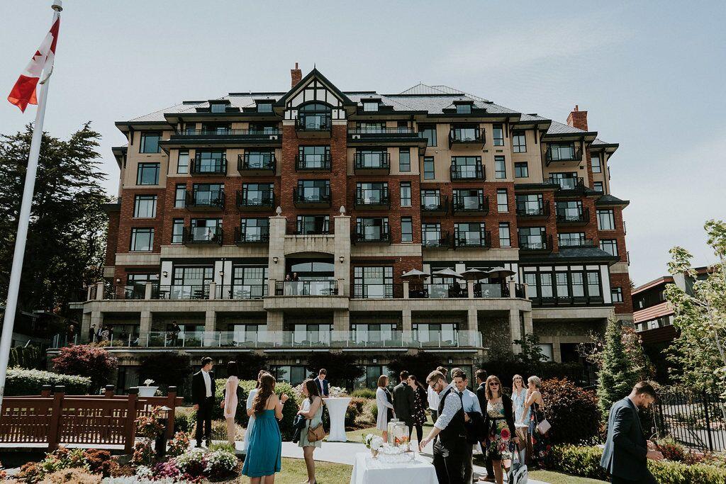 Romantic long shot of wedding ceremony at Oak Bay Beach Hotel on Vancouver Island