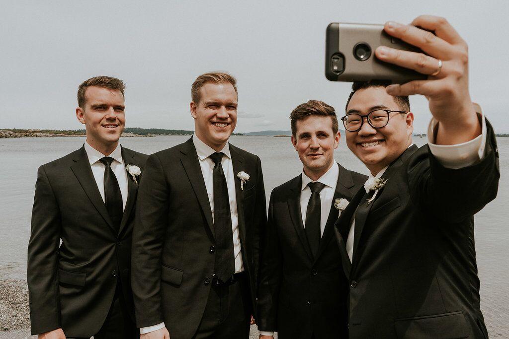 Groomsman take selfie shot together on Vancouver Island wedding