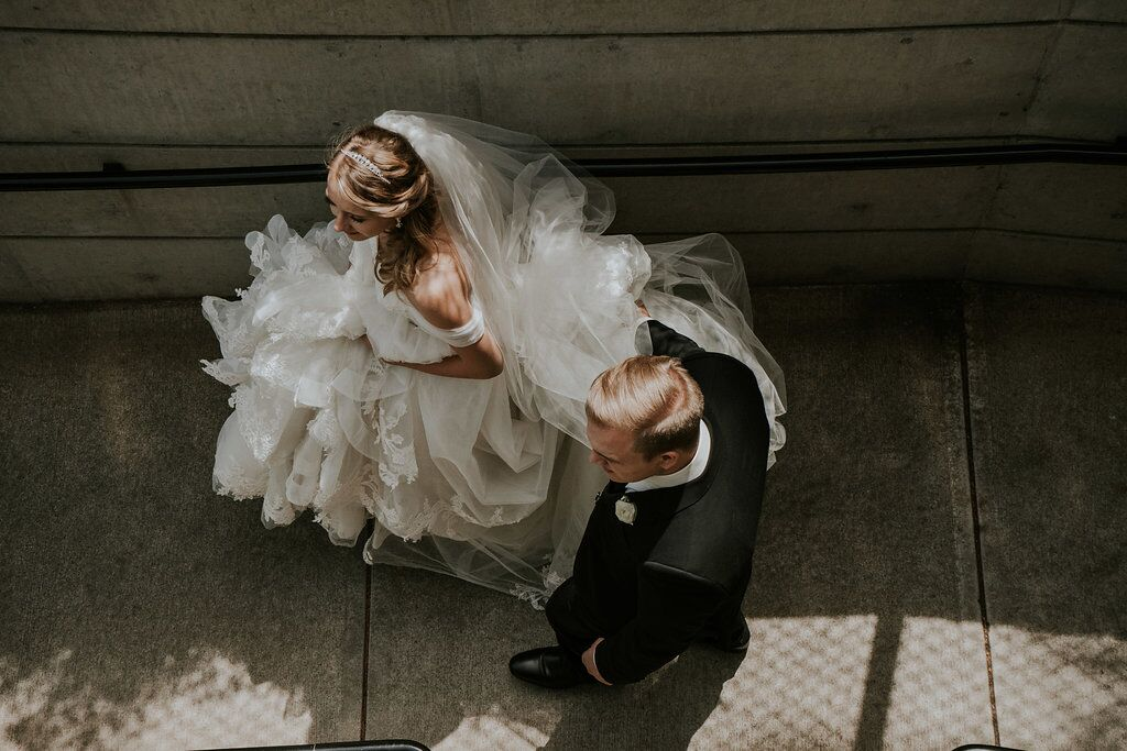 Romantic couple photo as bride and groom go down stairs at Oak Bay Beach Hotel