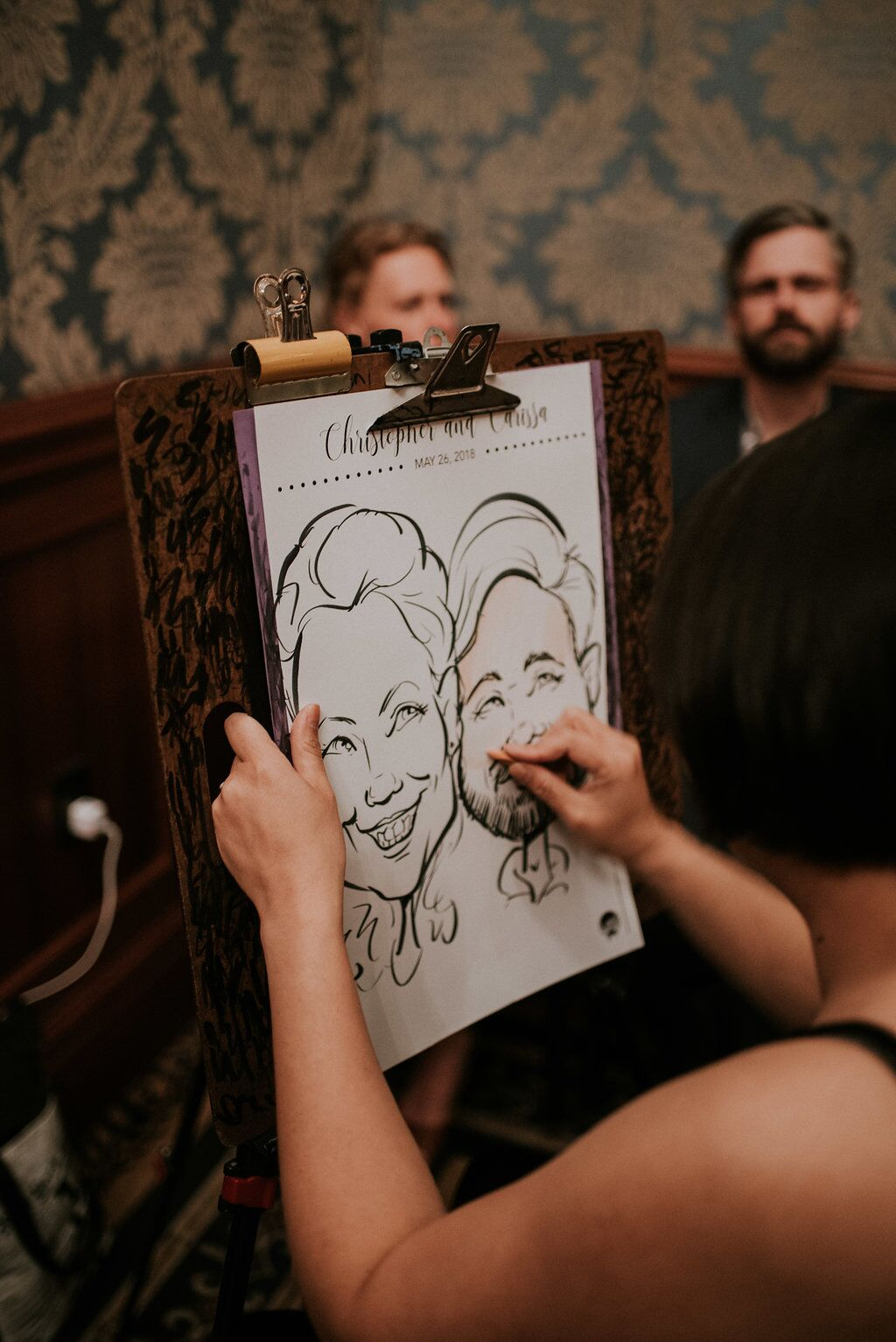 Caricaturist at Wedding Reception drawing guests