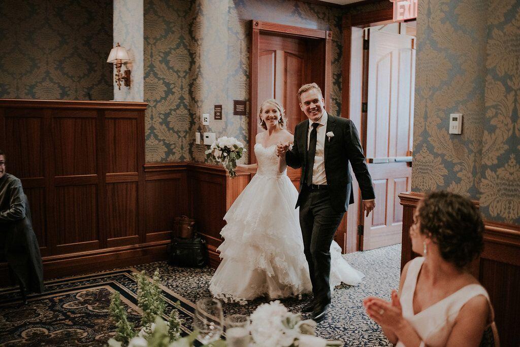 Newlyweds enter Oak Bay Beach Hotel reception on Vancouver Island