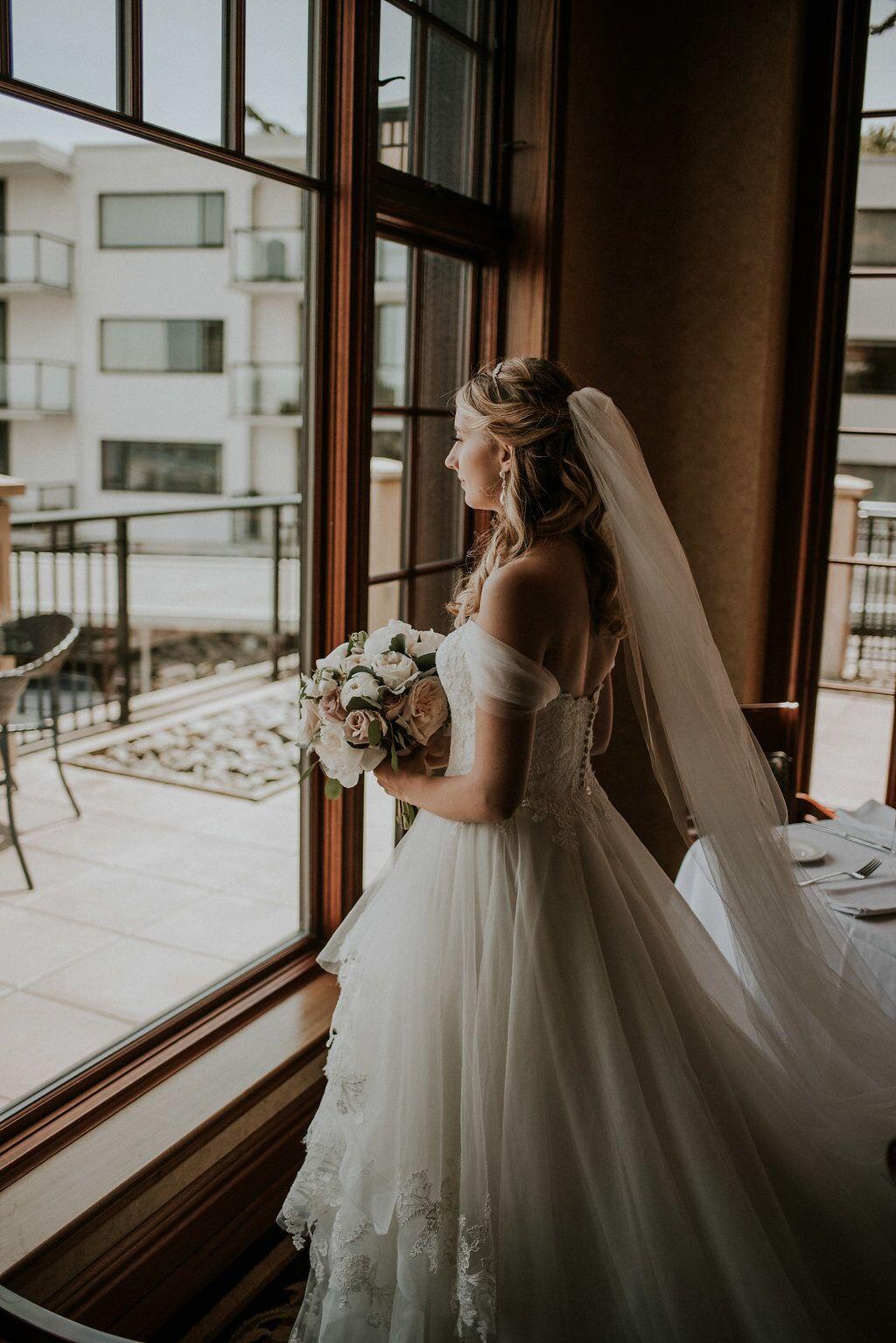 Romantic Bride at Oak Bay Beach Hotel looks out towards the ocean