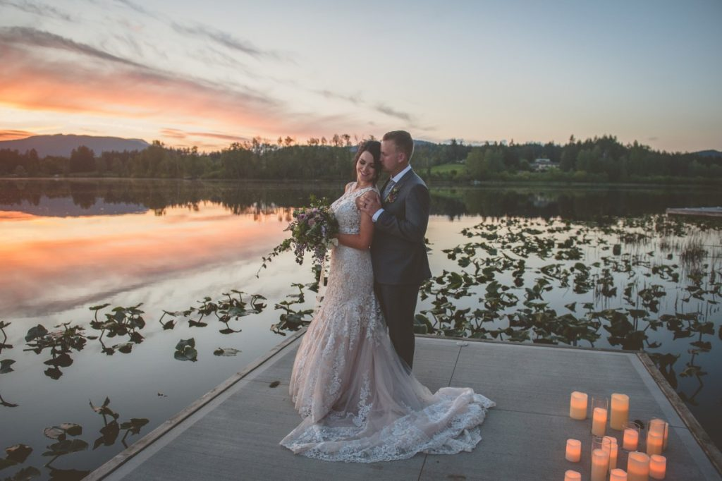 Bride and Group on Lake Deck with Sunset in Cowichan Valley
