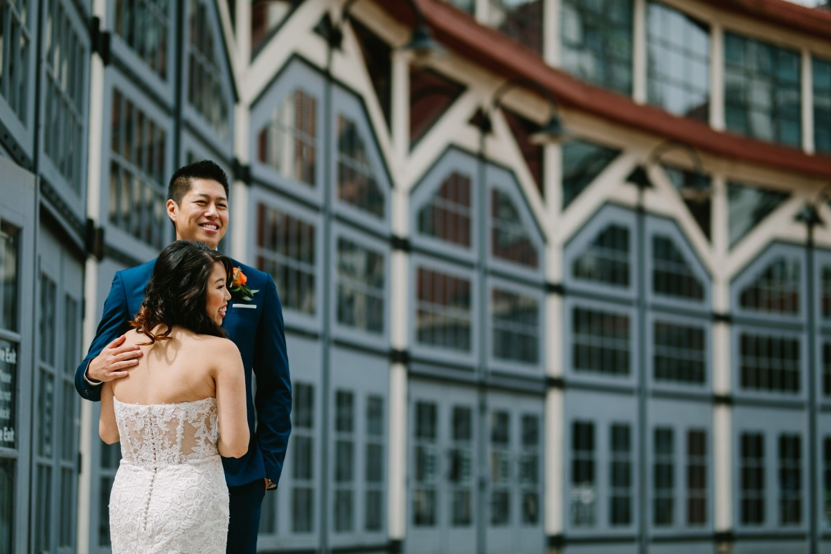 Vancouver Wedding Couple in front of city buildings