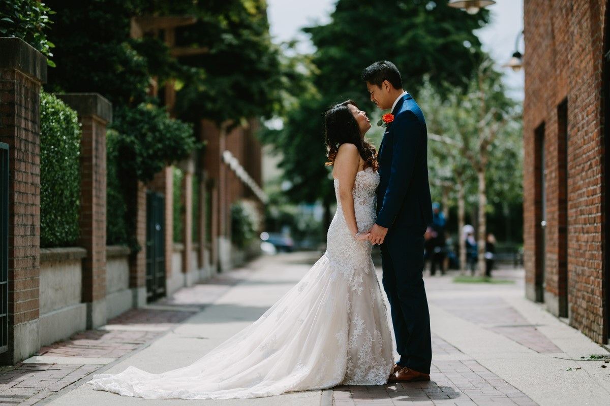 Chinese Fusion Wedding Couple on Vancouver Street Lined by Trees