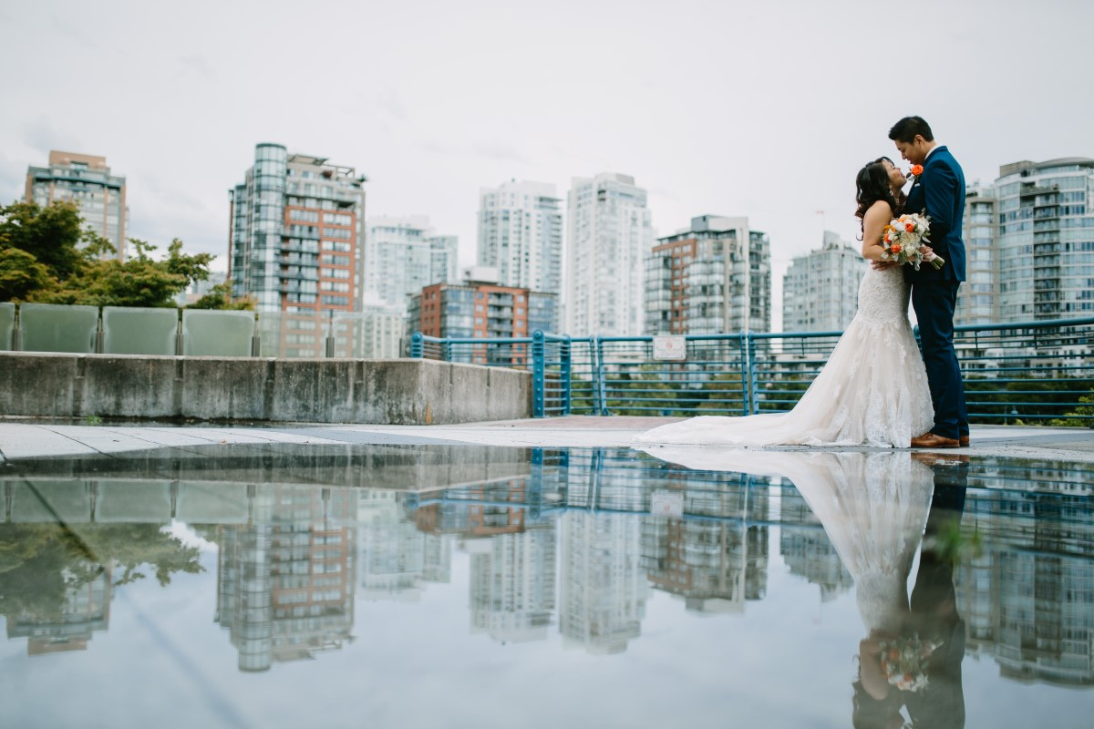 Chinese Wedding couple with Vancouver city line behind them