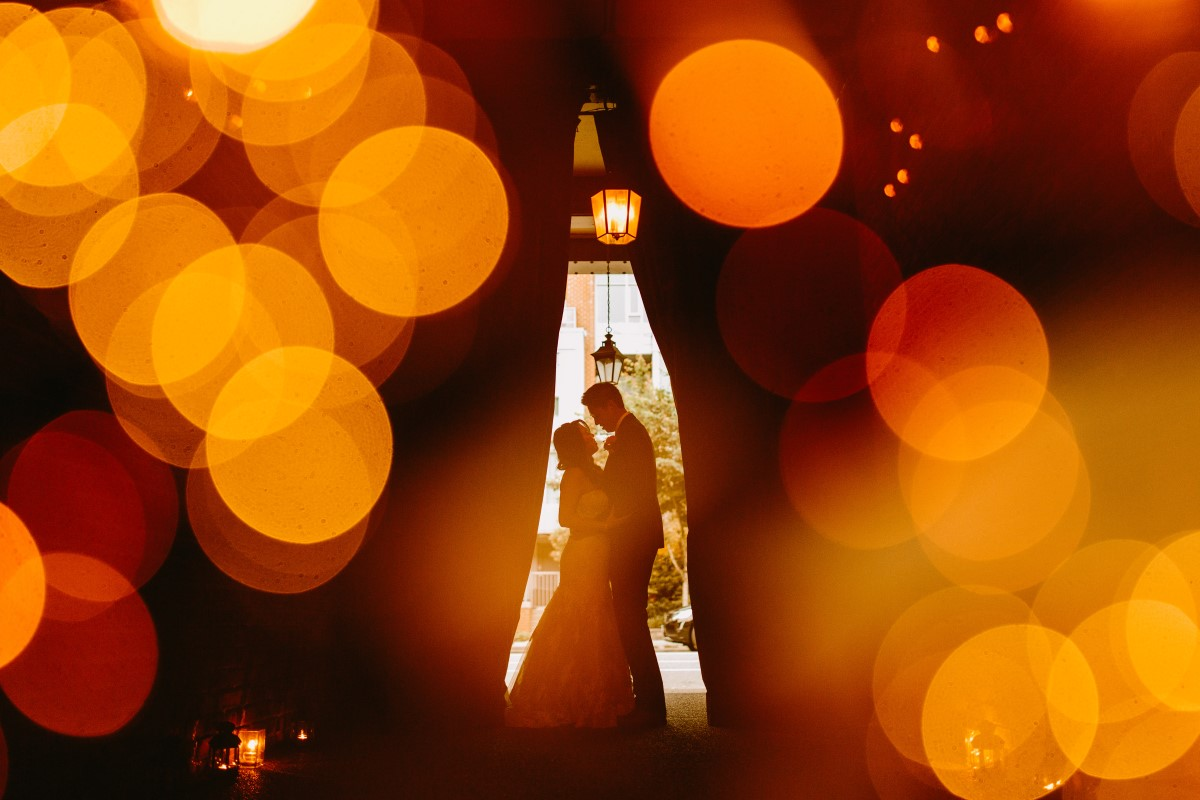 Newlywed couple surrounded by lights
